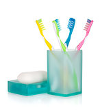 Four multicolored toothbrushes and soap