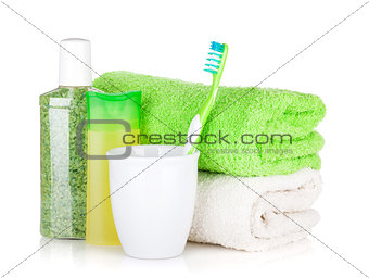Toothbrush, cosmetics bottles and towels