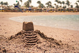 Castle on the sand on a beach.