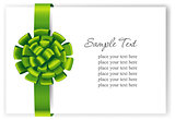 Greeting card with a green ribbon.