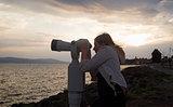 Woman using pay binocular