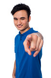 Young man pointing finger at you