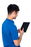 Young guy working on tablet device