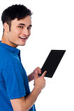 Smart guy holding touch pad