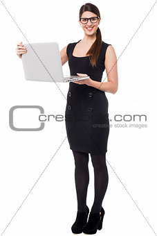 Smart corporate lady holding a laptop
