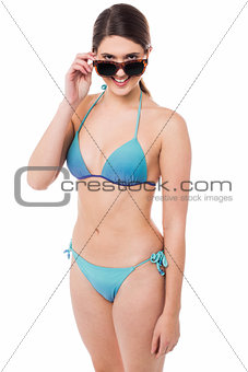 Flirtatious young babe in bikini and goggles