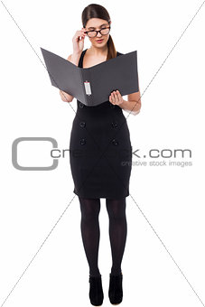 Corporate woman reviewing annual document