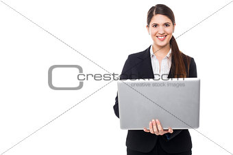 Attractive woman in formals working on laptop