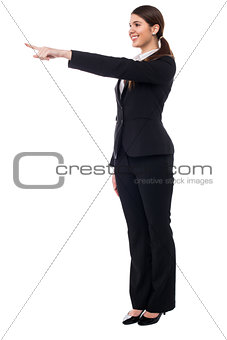 Corporate smiling woman pointing at something