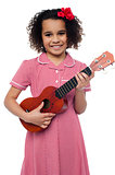 A little girl with a toy guitar