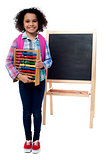School girl with abacus and pink backpack