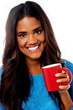 Smiling woman with coffee mug