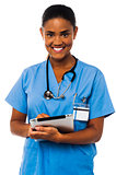 Female physician holding tablet pc