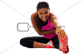 Fitness girl doing stretching exercise