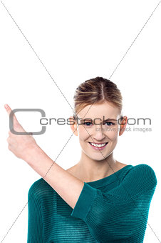 Charming female model pointing away