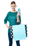 Girl holding shopping bags and credit card