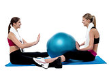 Fit women practicing an exercise with pilates ball