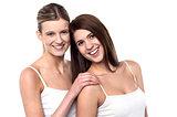 Two attractive girls posing in sleeveless spaghetti