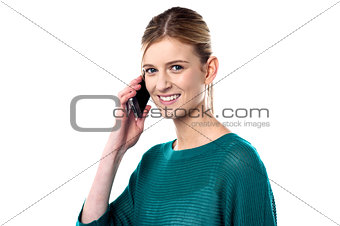 Cute young girl talking on mobile phone