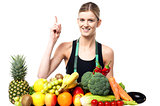 Pretty slim girl with fruits and vegetables