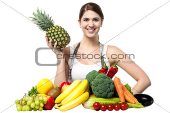 Beautiful young woman with fruits and vegetables