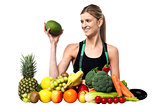 Attractive girl with heap of fruits and vegetables