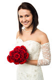 Smiling bride with a rose bouquet