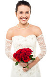 Gorgeous pretty bride with a rose bouquet