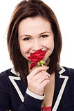 Lovely young girl with a beautiful red rose