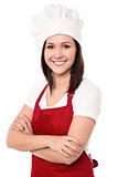 Cheerful confident young female chef