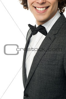 Groom in pose against white background