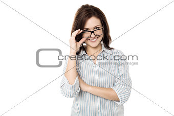 Cute woman adjusting her eyewear