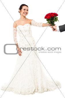 Groom presenting beautiful bride love roses