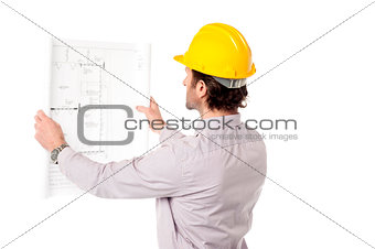 Architect reviewing building plan