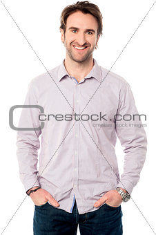 Casual studio shot of a cheerful young man