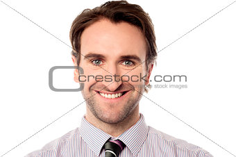Smiling businessman looking at you