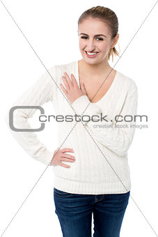 Attractive girl resting arm across her chest
