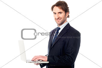Business professional browsing on laptop