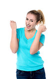 Excited charming girl with clenched fists