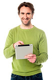 Young guy operating tablet device