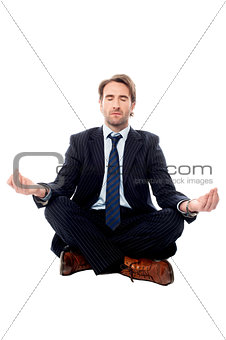Smart businessman doing meditation