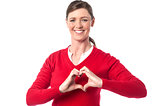 Woman making heart symbol with hands