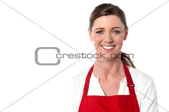 Attractive female chef wearing red apron
