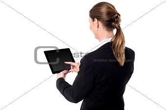 Business woman using a tablet device