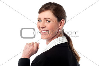Business woman turns back and looks over