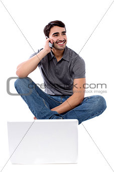 Smart guy communicating through cellphone
