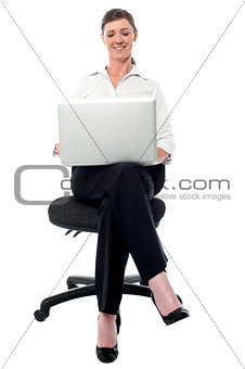 Corporate lady working on her laptop