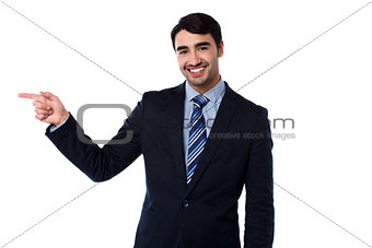 Smart businessman pointing at something