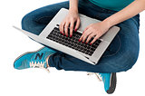 Cropped image of a girl working on laptop