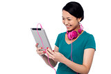 Adorable girl watching video on tablet device